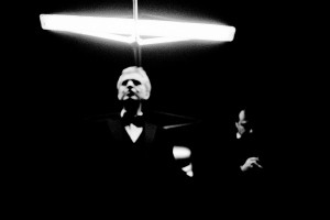 Andrea Bocelli standing under the lamp with his tour manager Massimo Nebuloni in the background.
