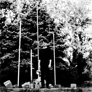 Masayoshi Fujita standing at the tubes in a park with trees.