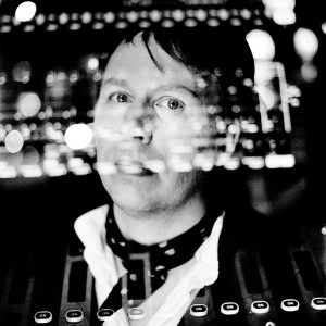 Double exposure of Oscar Simonsson from duo Koop with sound mixer.