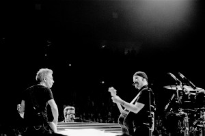 U2 members The Edge, Bono Vox and Adam Clayton on the stage at the concert playing.